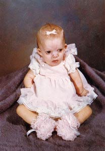 About Debbie Jorde. with daughter, Heather Madsen, 2 1-2 months old.